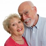 A happy senior couple who is young at heart.  Isolated with room for text.